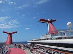 Just a little height difference between Carnival Elation and Glory