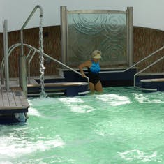 Entering the warm water of the Thalassasotheraphy pool.