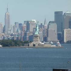 NY Skyline taken from ship with Statue Of Liberty