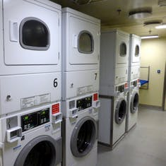 Inside the laundry room - 8 quarters for a wash - free dry