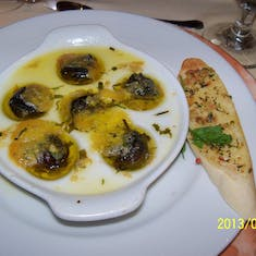 In 2008 my cousin bet $5 that I would not eat snails. I won and I LOVE them now.