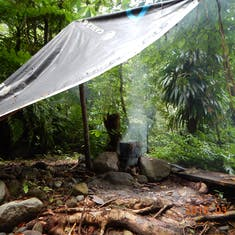 Dominica, rain forest hike to Sari Sari Falls. Our lunch cooking.