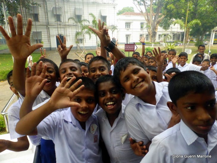 School Boys wavi8ng to me at the Colombo Museum - Amsterdam