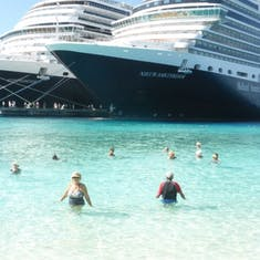 Swimming at the beach with the ships in the background