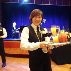 Our Wine Steward, Jennalyn Serves us Drinks in the Showroom - Mariner Society Ceremony