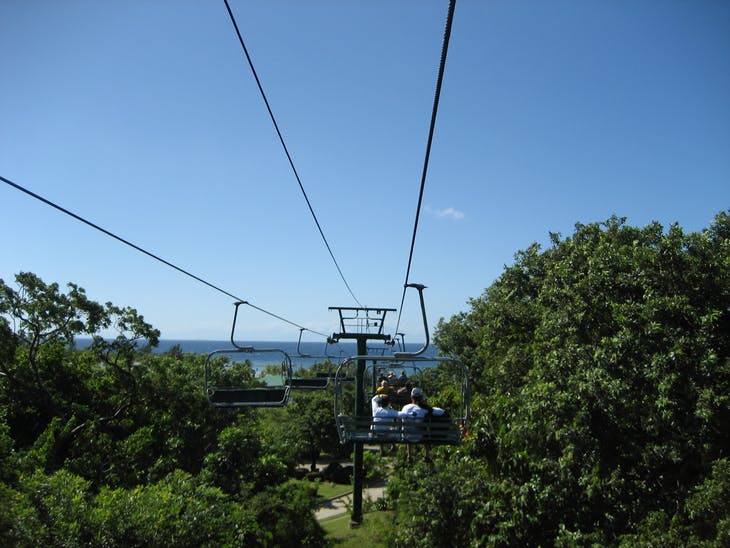 Mahogany Bay, Roatan, Bay Islands, Honduras - Flying Beach Chair through trees