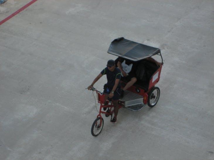 Cozumel, Mexico - Pedicab retuning a passenger