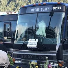 "Funny photo of the tour bus sign, ""Wrong Coach""."