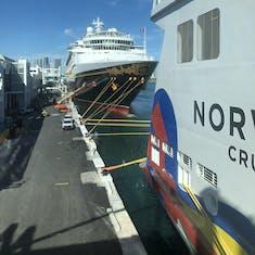 Norwegian Encore docked in front of Disney Magic in Miami