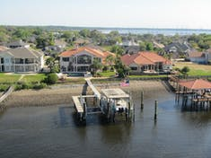 Homes along the St John's river.  People stand on their patios and wave as the ship passes.