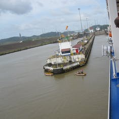 Panama Canal Transit - Rowers taking our lines to mules.