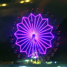 Ferris Wheel seen from our swhip lit up at night