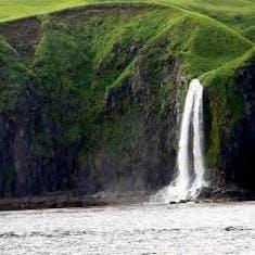 Dutch Harbor, Alaska - Waterfalls seen from the ship aqfter leaving Dutch Harbor
