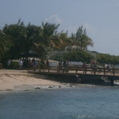 A dock at Grand Turk with humpback whale statue in the background
