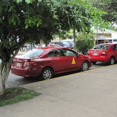 Puntarenas, Costa Rica - Taxis are red in Puntarenas