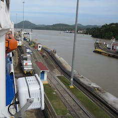 Panama Canal Transit - Mules (small locomotives) keepin the ship centered.