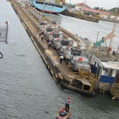 Panama Canal Transit - Mules lined up for Gatun Locks transit.