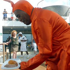 Lobster Man serves us food from the cooking demonstration