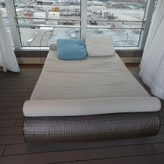 One of the lounging beds, Deck 10 facing the pool below.