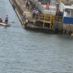 Panama Canal Transit - Crew taking our lines to the mules in Gatun Locks
