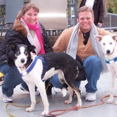 Amy & Mike with two of Iditarod champion Libby Riddles' sled dogs.